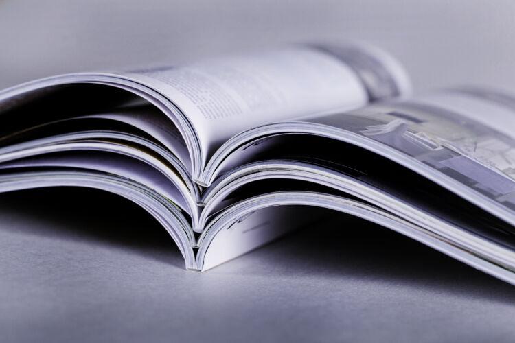 pile,of,open,magazines,,toned,image