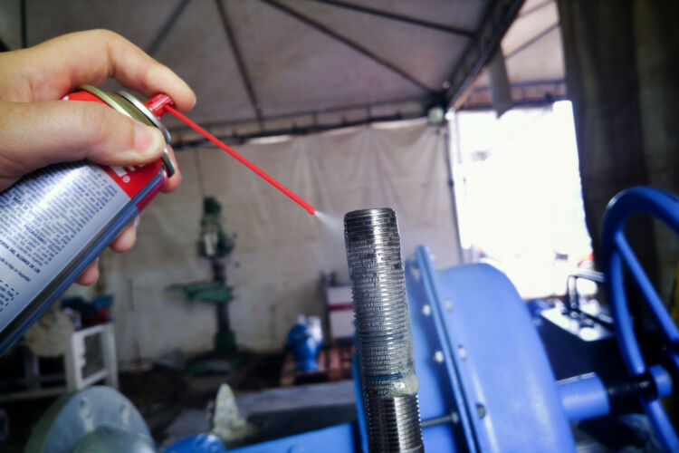 hand,apply,degreasing,oil,spray,degreaser,and,lubricant,on,stainless